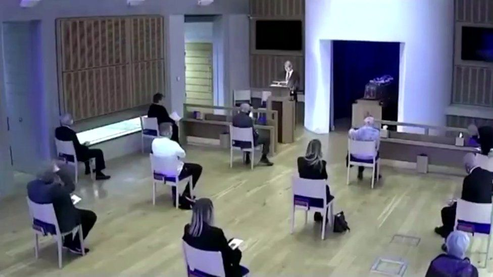 Still taken from video of Craig Bicknell's father's funeral service
