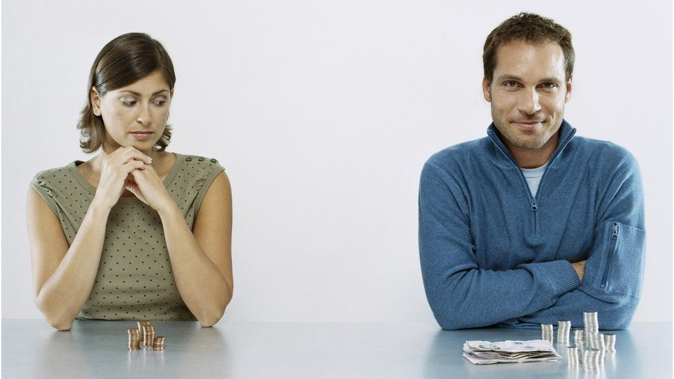 woman and man with piles of cash