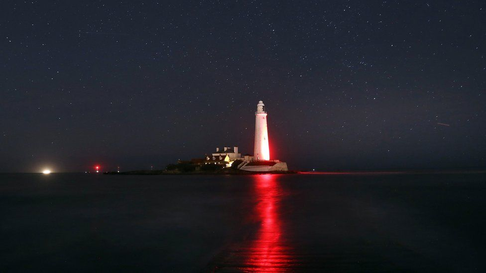 St Mary's Lighthouse, Whitley Bay, glows red in honour of the centenary