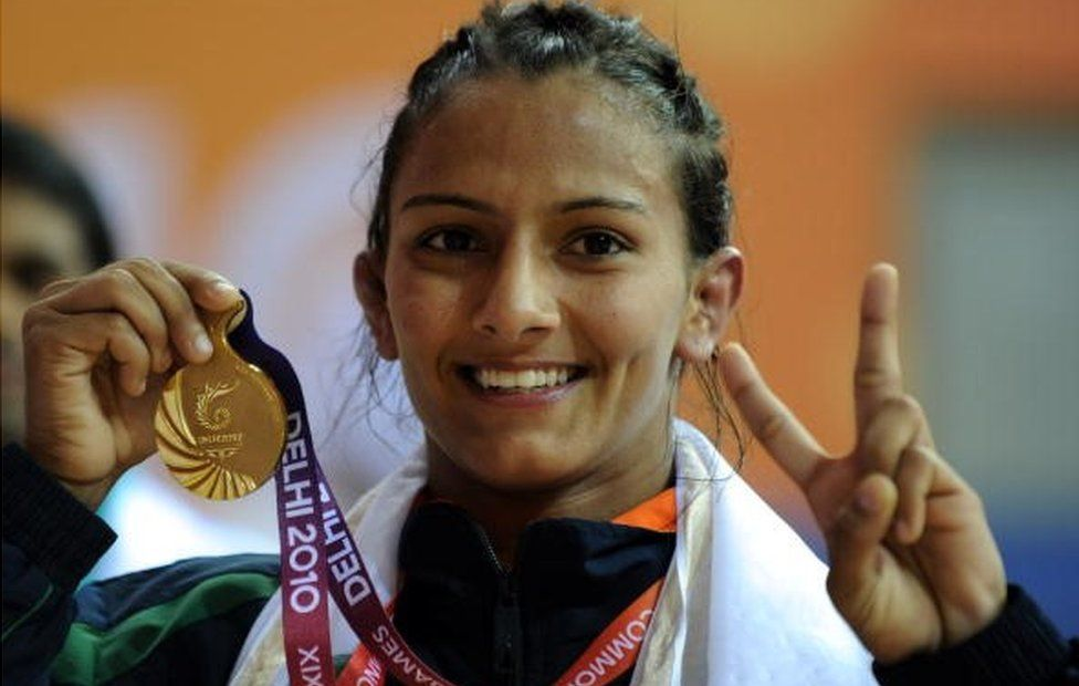 India's Geeta celebrates with her gold medal after defeating Australia's Emily Bensted in the women's wrestling 55 kg final at the XIX Commonwealth Games 2010 in New Delhi on October 7, 2010.