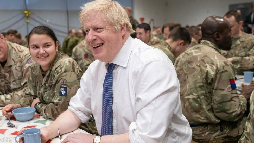 """Britain""""s Prime Minister Boris Johnson meets British troops stationed in Estonia for a meal at the Tapa military base"""