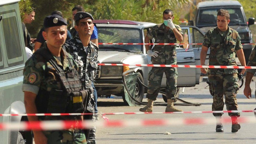 Lebanese soldiers at the scene of multiple suicide bomb attack in Lebanon
