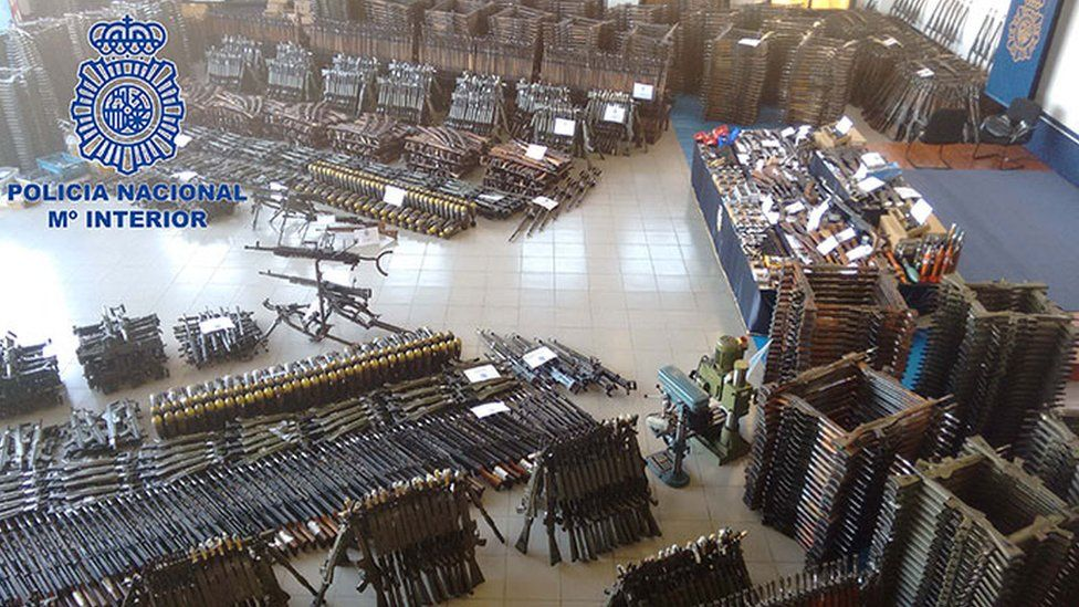A picture showing the large stockpile of guns seized by Policia Nacional
