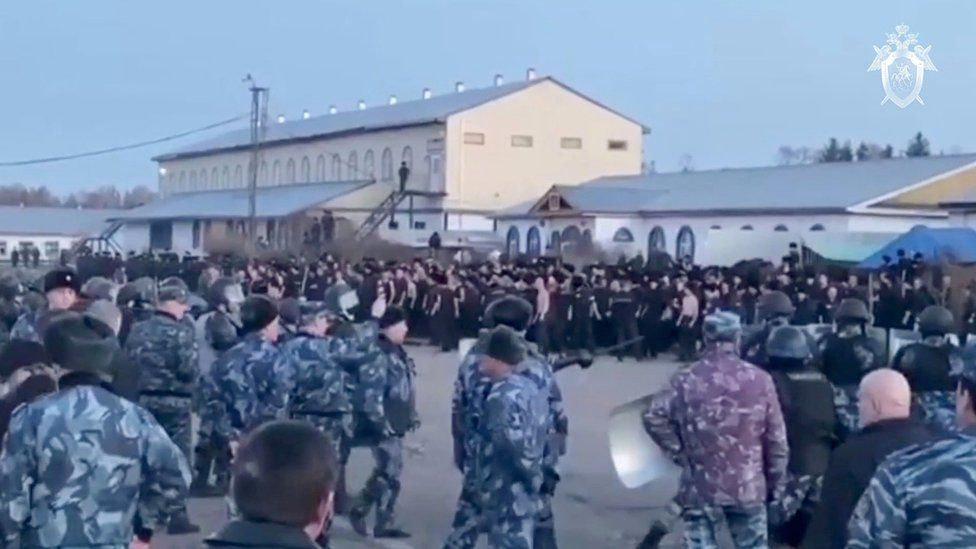 A still image taken from a video released by the Investigative Committee of Russia, showing inmates standing by guards
