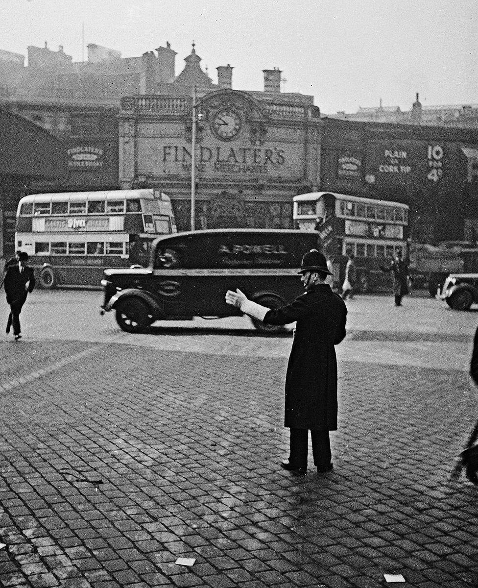Policeman on traffic duty, London, 1937