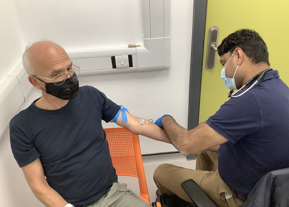 A volunteer having a blood sample taken at the vaccine trial clinic