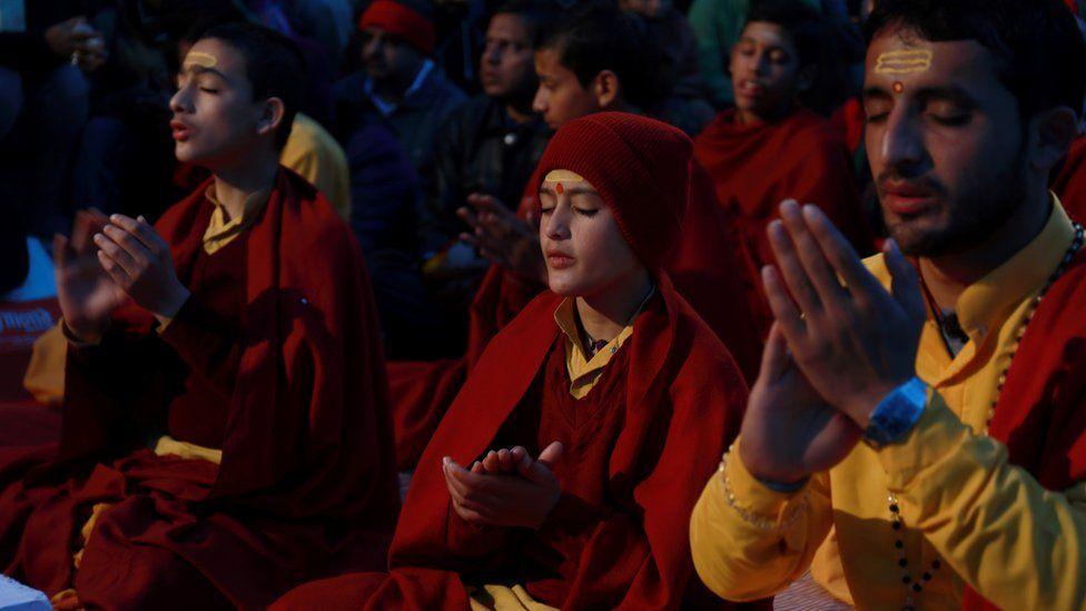 People in prayer in Rishikesh, India - January 2017