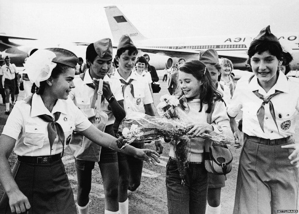 Schoolgirl Samantha Smith (1972 - 1985) (second right) is greeted by Russian Young Pioneers at the airport, Crimean Peninsula, Russia