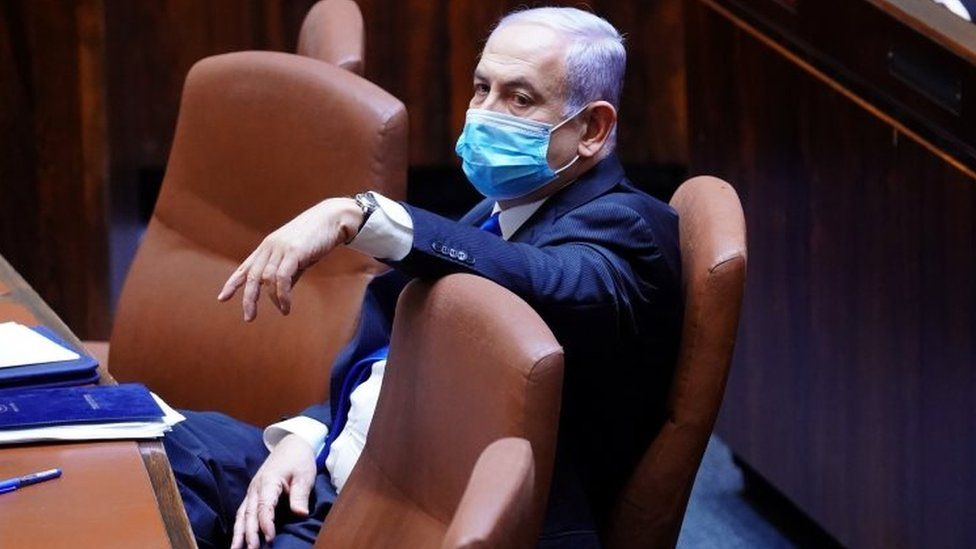 Israeli Prime Minister Benjamin Netanyahu wears a mask before a swearing in ceremony of a unity government in parliament in Jerusalem. Photo: 17 May 2020