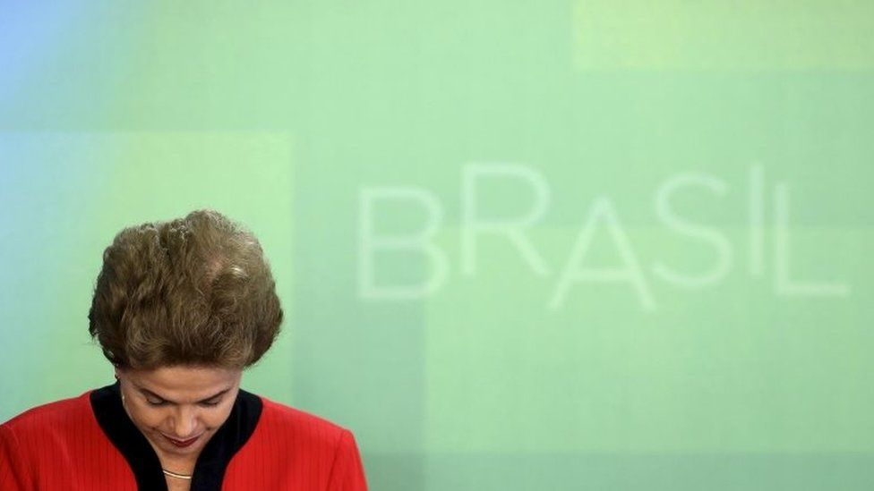 President Dilma Rousseff reacts during a signing ceremony of a deal between mining company Samarco and its owners, BHP Billiton and Vale SA, with the Brazilian government at the Planalto Palace in Brasilia, Brazil, March 2, 201