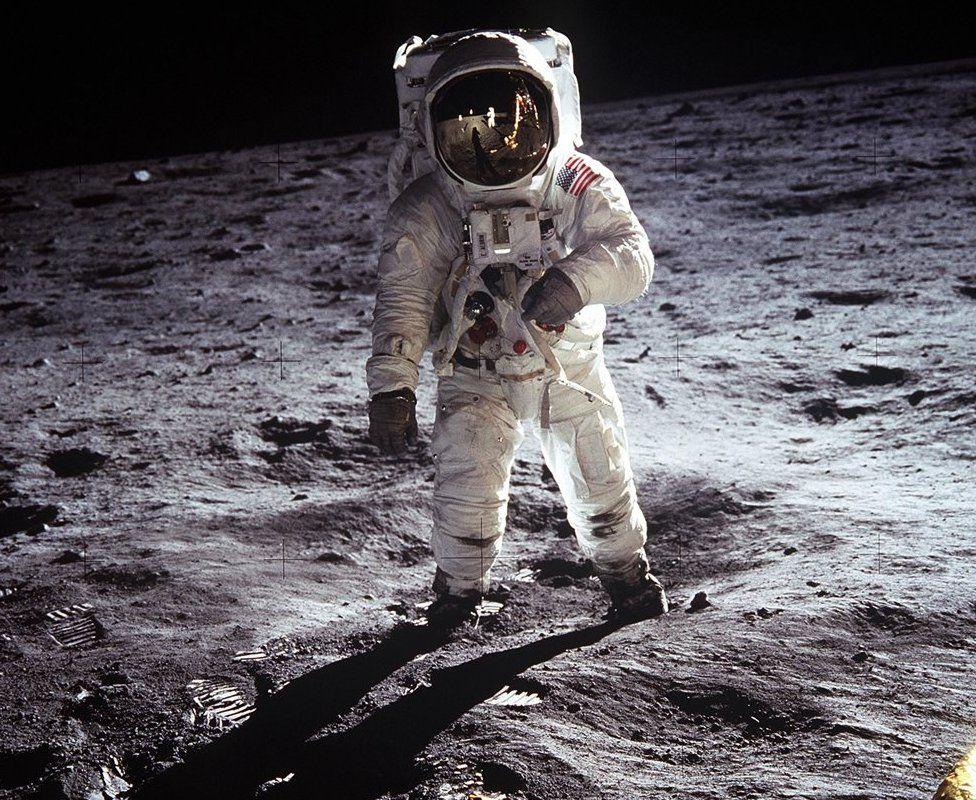 Buzz Aldrin walks on the moon