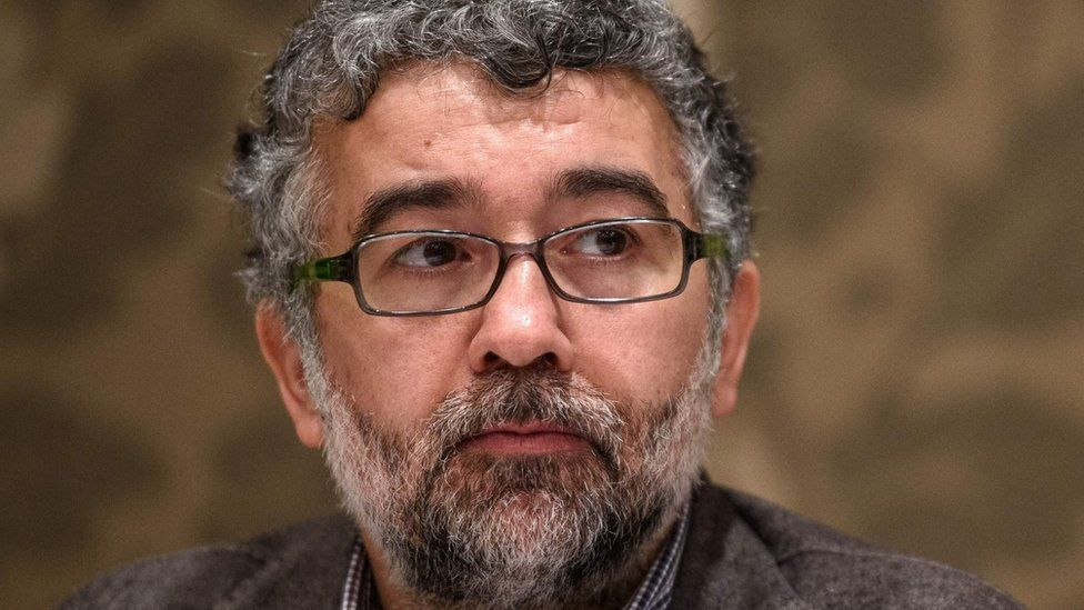 A picture taken on 2 March 2016 shows Erol Onderoglu, the Turkey representative for international rights group Reporters Without Borders (RSF), during a press meeting in Istanbul.