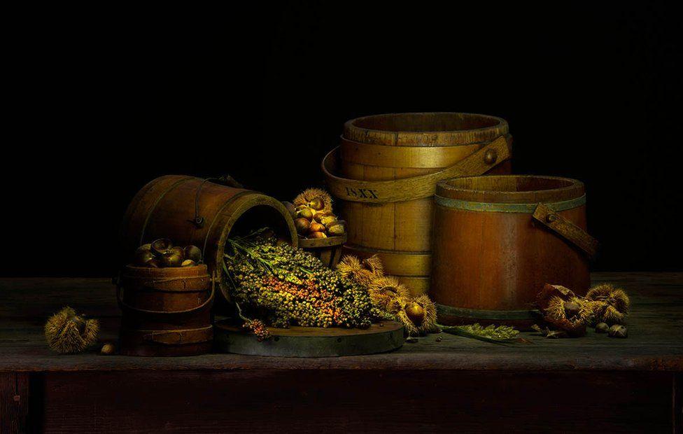 A still life of barrels and vegetables