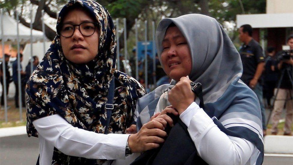Two emotional women arrive at Soekarno Hatta International airport near Jakarta