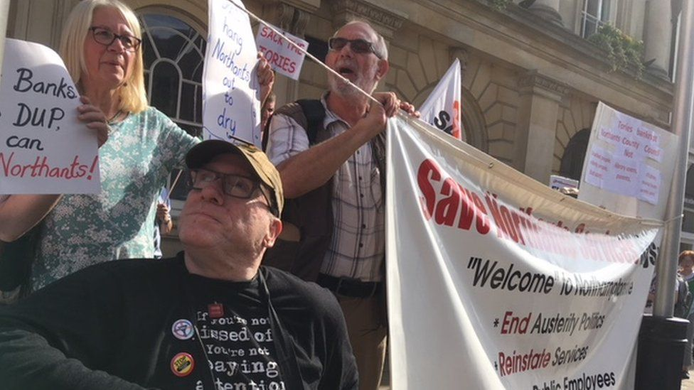 Protesters outside Northamptonshire County Council