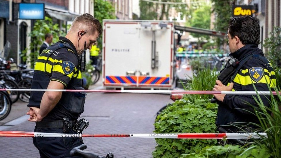 Police at the site of a shooting in Amsterdam, the Netherlands