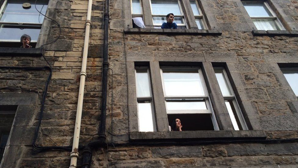 Locals hanging out of their windows had prime position for the Holywood visitor