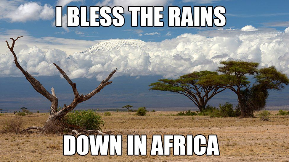 """A meme of Mount Kilimanjaro with the words """"I bless the rains down in Africa"""""""