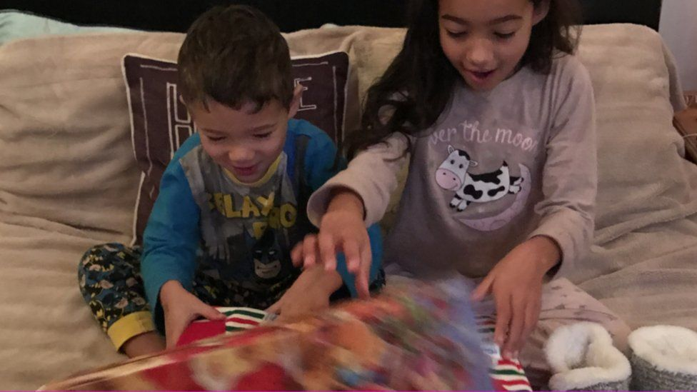 Children Isaac and Olivia opening their boxes