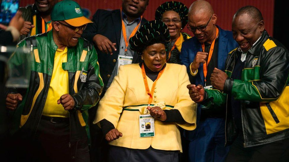 South African President Jacob Zuma (L), former African Union Chairperson and presidential hopeful Nkosazana Dlamini-Zuma (C) and South African Deputy President Cyril Ramaphosa (R) dance after the closing session of the South African ruling party African National Congress (ANC) policy conference on July 5, 2017 in Johannesburg, South Africa