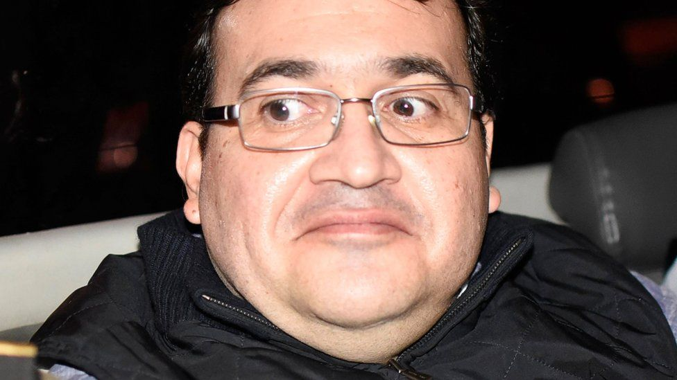 Javier Duarte, former governor of the Mexican state of Veracruz, is seen in a car following his arrest upon his arrival at the Matamoros military barracks in Guatemala City on April 16, 2017