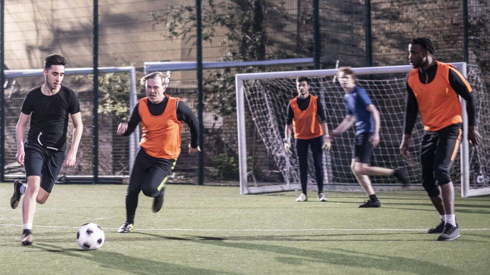 People playing five-a-side football
