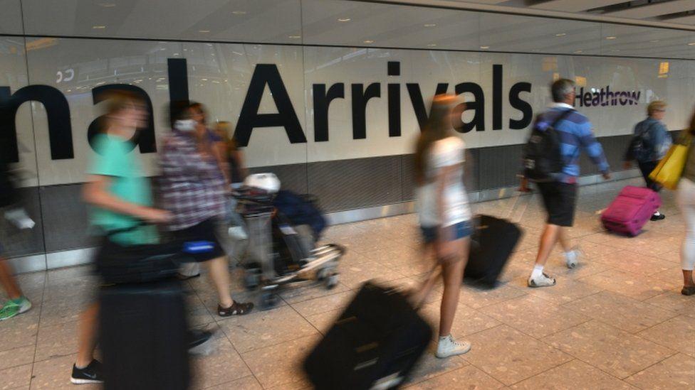 Passengers at Heathrow arrivals