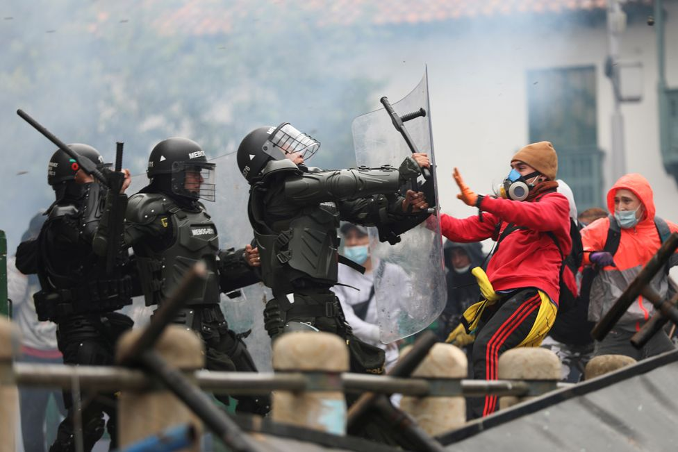 Demonstrators clash with members of security forces during a protest against tax reforms in Bogotá, Colombia, on 28 April 2021