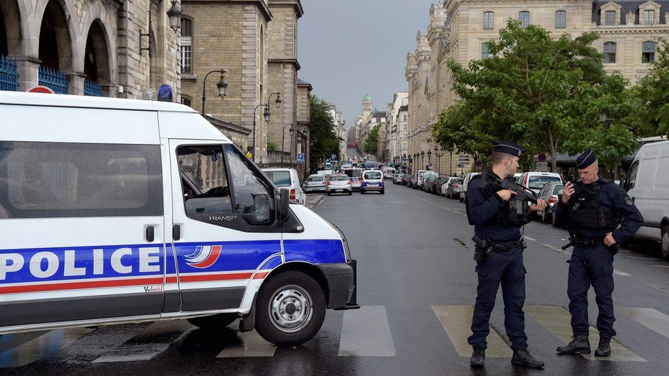 French police officials gather at the entrance to Notre-Dame Cathedral