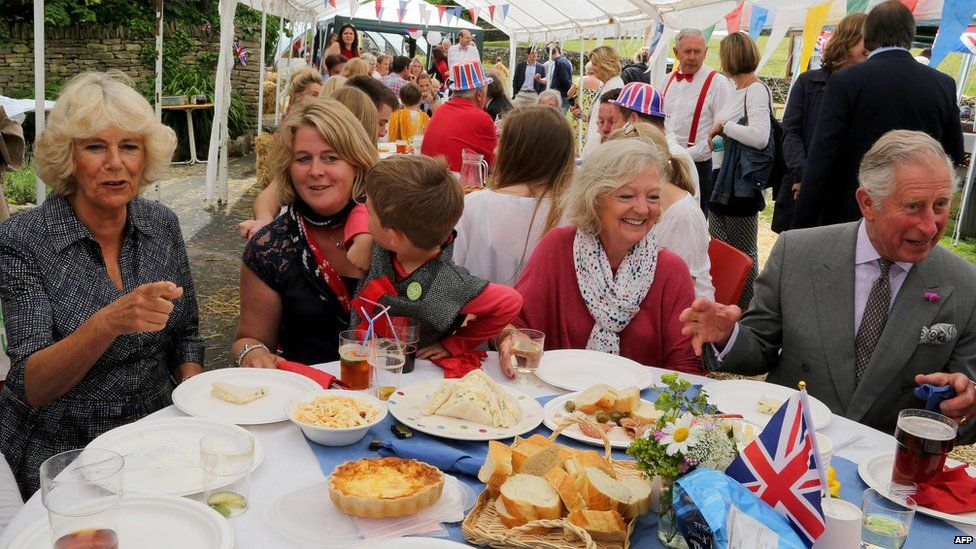 The Duke and Duchess of Cornwall attend a party in Gloucestershire