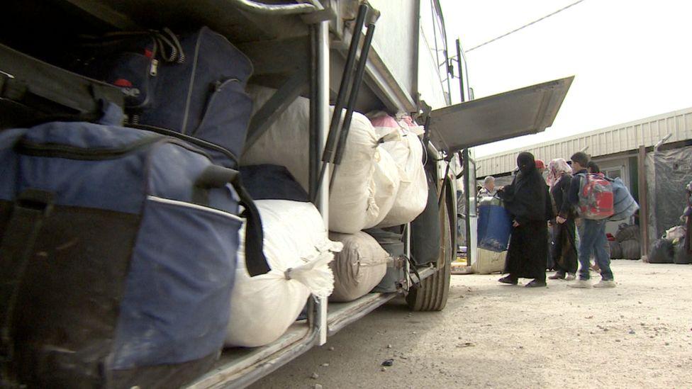 Bags being loaded onto bus at Zaatari refugee camp bound for Jordan-Syria border