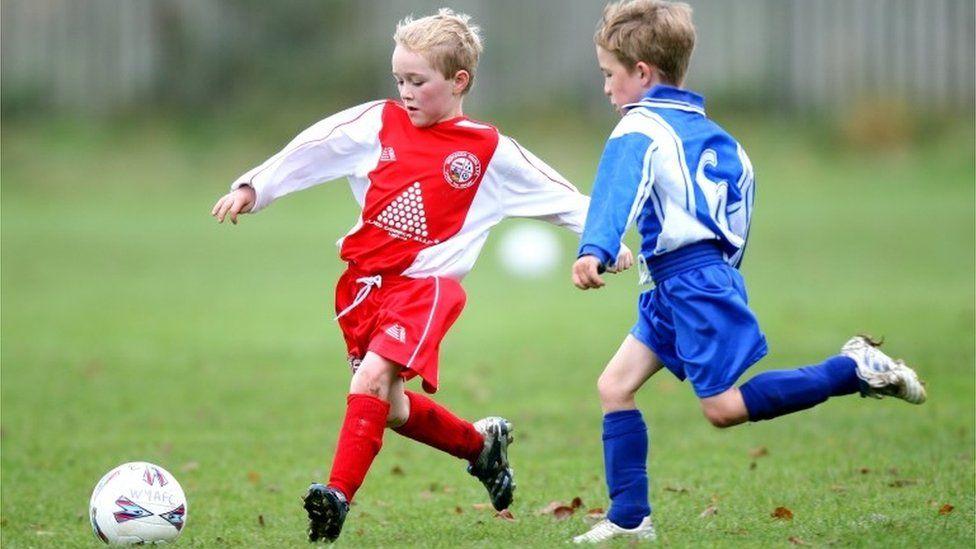 Boys playing football