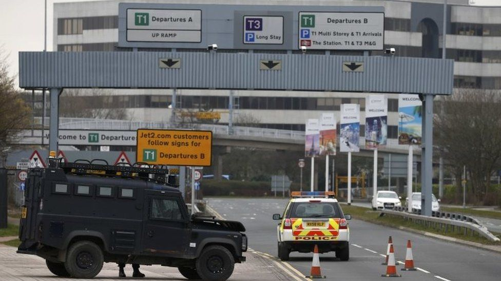 An armed police vehicle is seen at Manchester Airport in Manchester