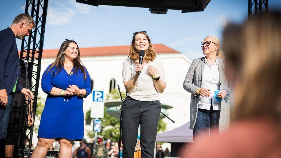 Jamila Schäfer speaking at an event
