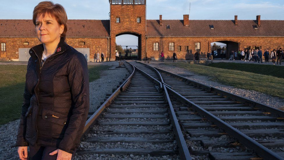 Nicola Sturgeon standing at the camps notorious railway station