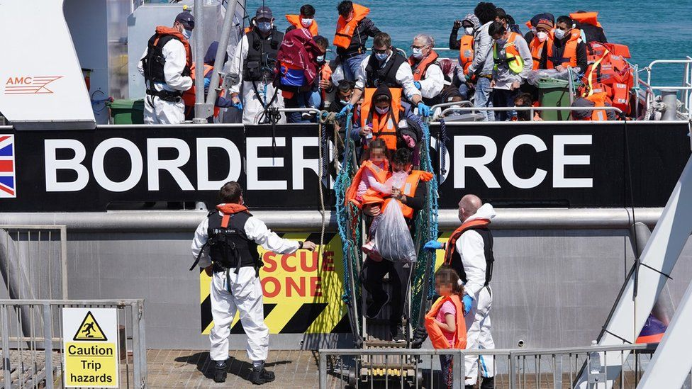 Migrants leave Border Force vessel in Dover on 5 August 2021 (file image)