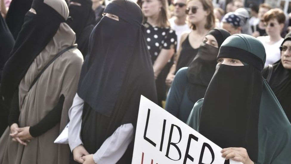 Women, dressed in burkas, in Denmark protesting against the country's new law