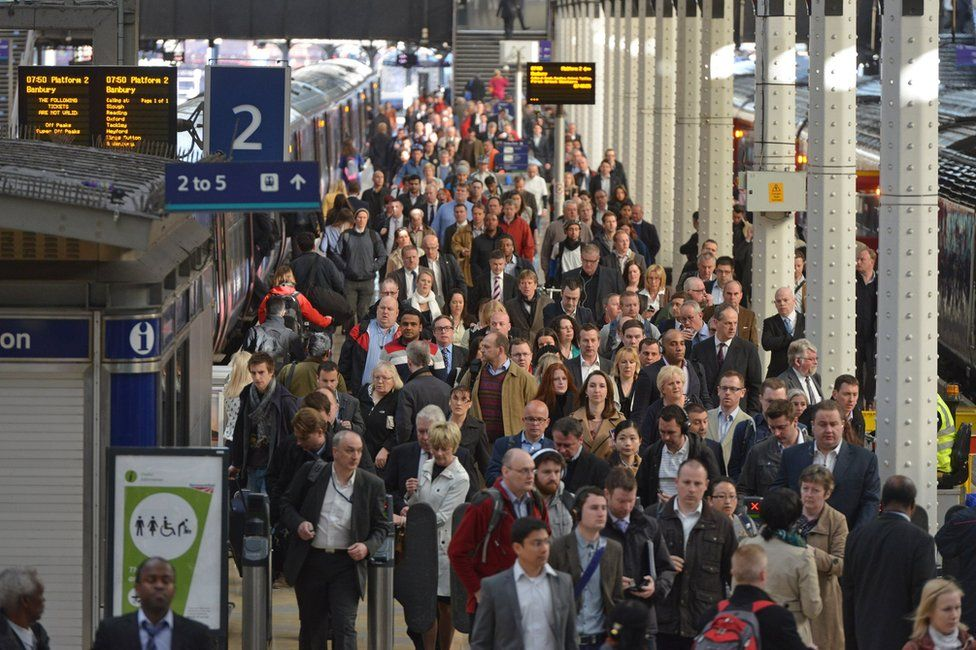 Commuters at Paddington station in London