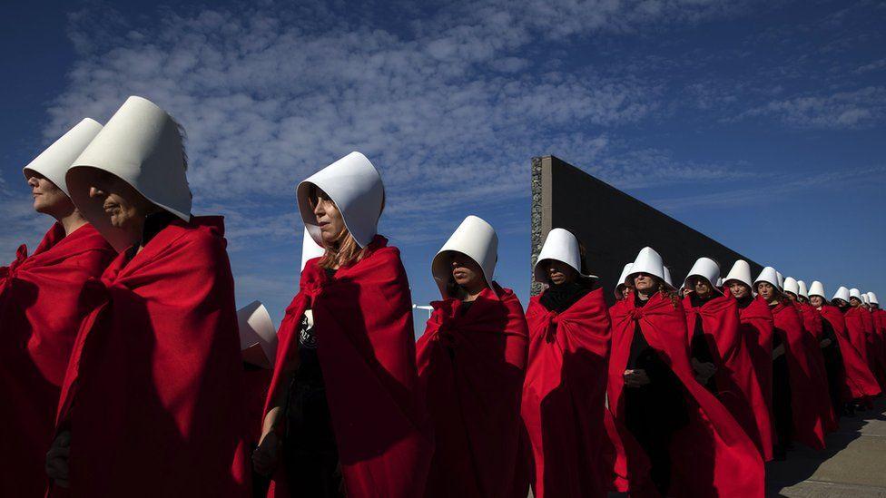 Activists dressed as handmaids