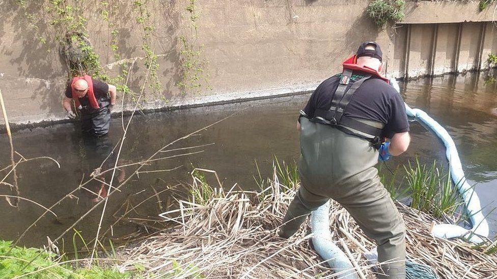 Boom being placed in River Derwent