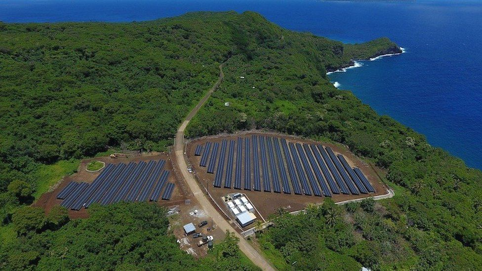 Solar panels on Ta'u, American Samoa, and its nearby power storage battery plant, seen fro the air