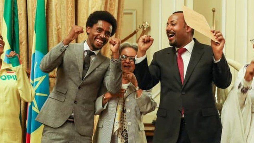 Feyisa (l) President Sahle-Work Zewde (c) and Prime Minister Abiy Ahmed (r)