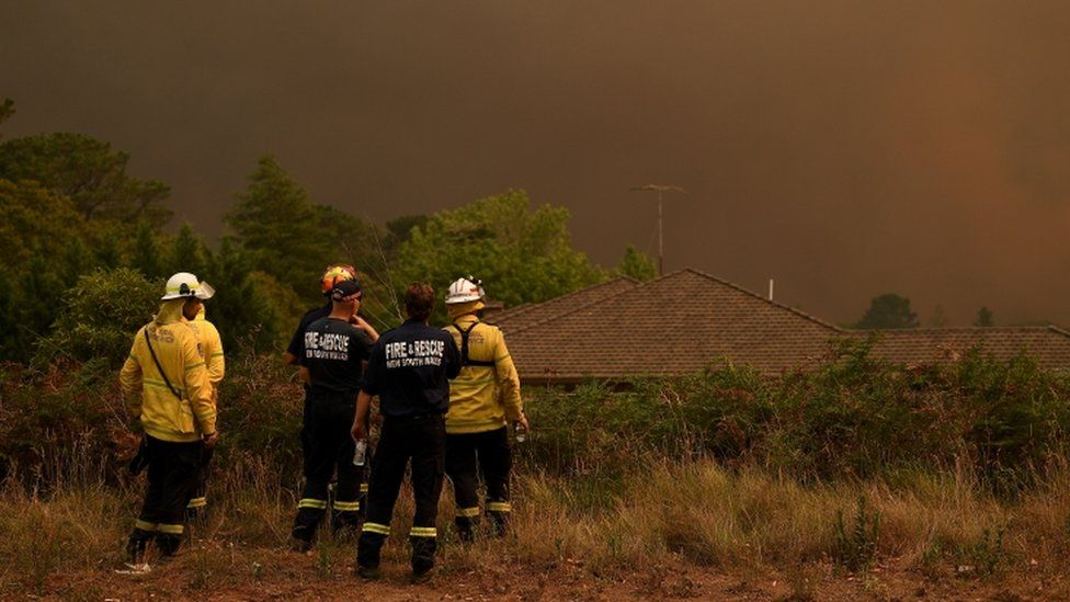 New South Wales firefighters watch as the Grose Valley Fire approaches Kurrajong Heights