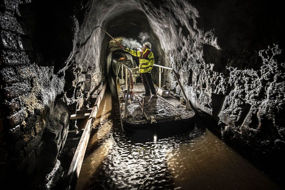 A member of the Canal & River Trust inspects the Standedge Tunnel