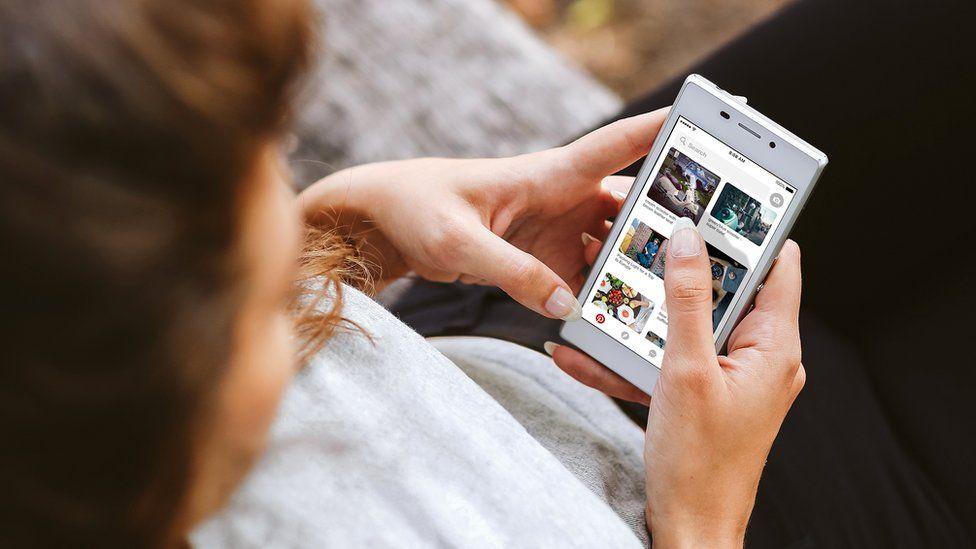 Woman using Pinterest