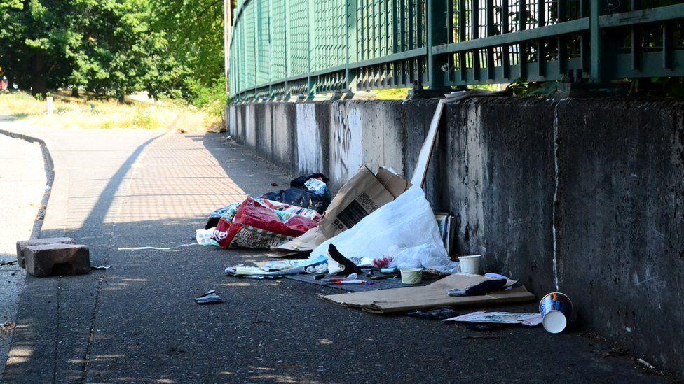 Trash left behind on a street in Portland