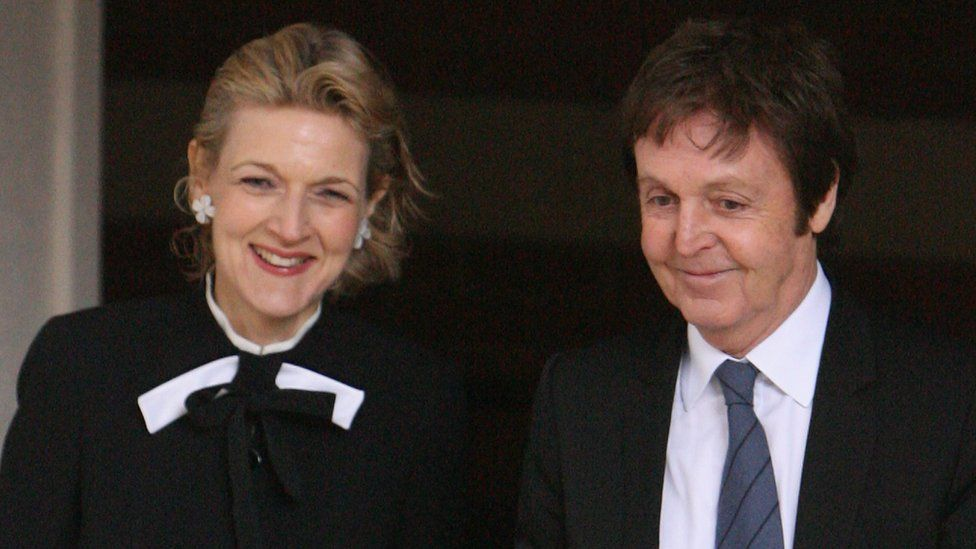 Sir Paul McCartney and his divorce lawyer Fiona Shackleton leave the High Court on 17 March 2008
