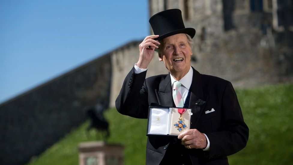 Nicholas Parsons with his Commander of the Order of the British Empire (CBE) medal given to him by Queen Elizabeth II at an Investiture ceremony at Windsor Castle on April 15, 2014