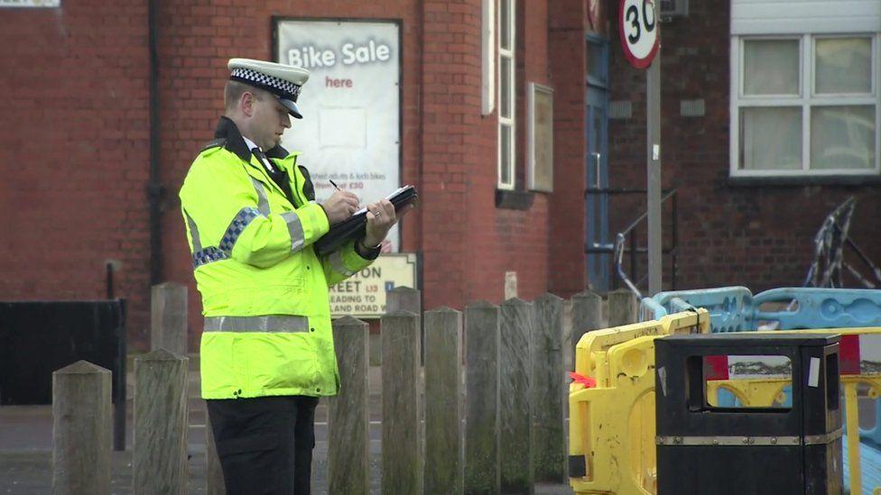 Police officer at Old Swan crash scene