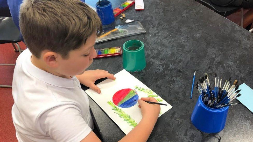 Child in art lesson